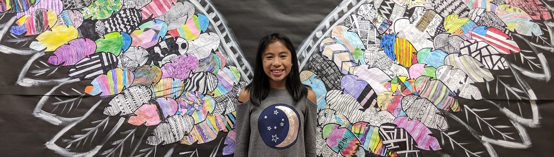HHES student with wings